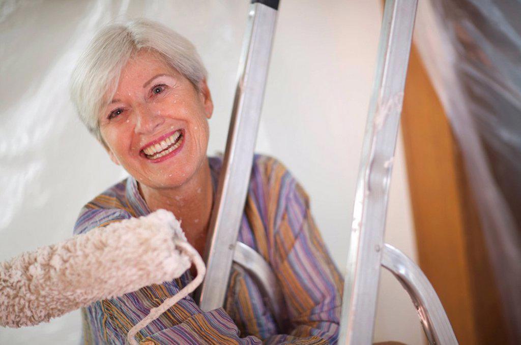 Stock Photo: 1773R-118600 Mature woman doing DIY
