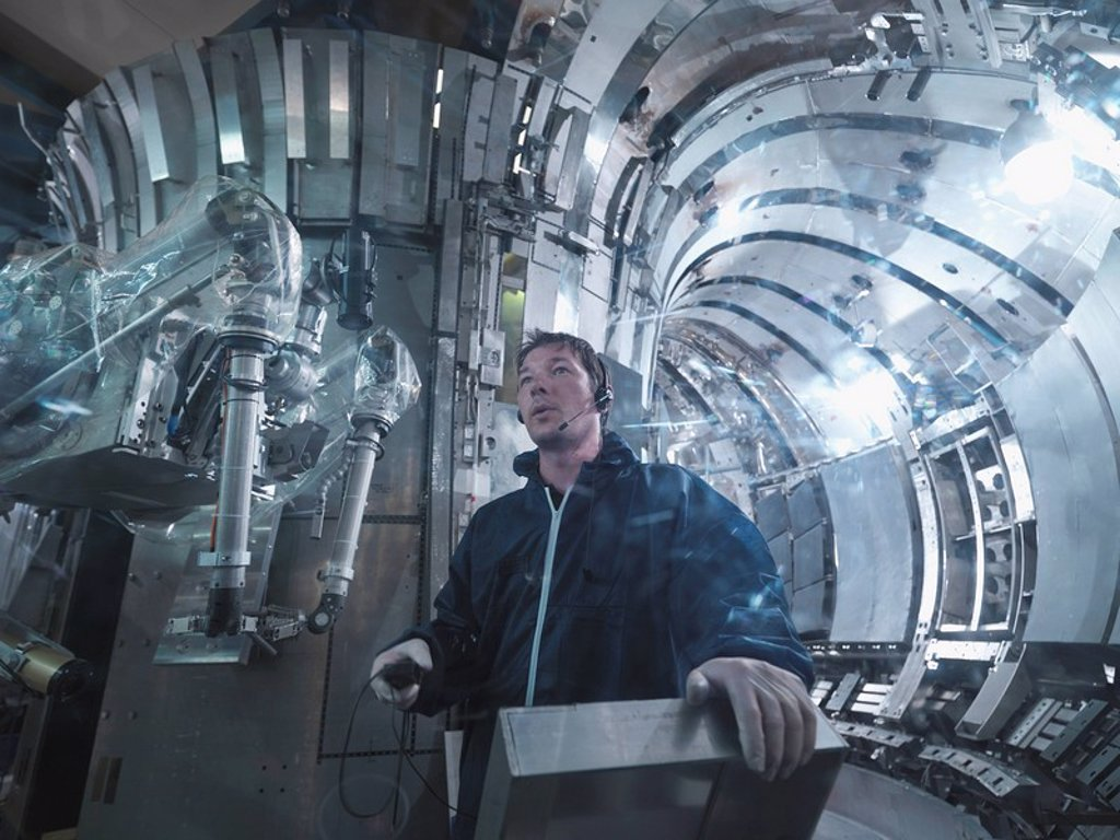 Scientist Working In A Fusion Reactor : Stock Photo