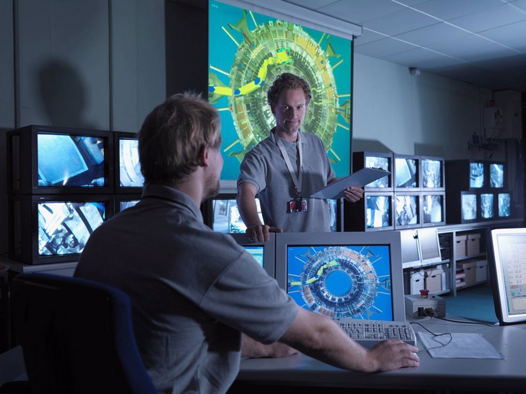 Fusion Reactor Scientists At Work : Stock Photo