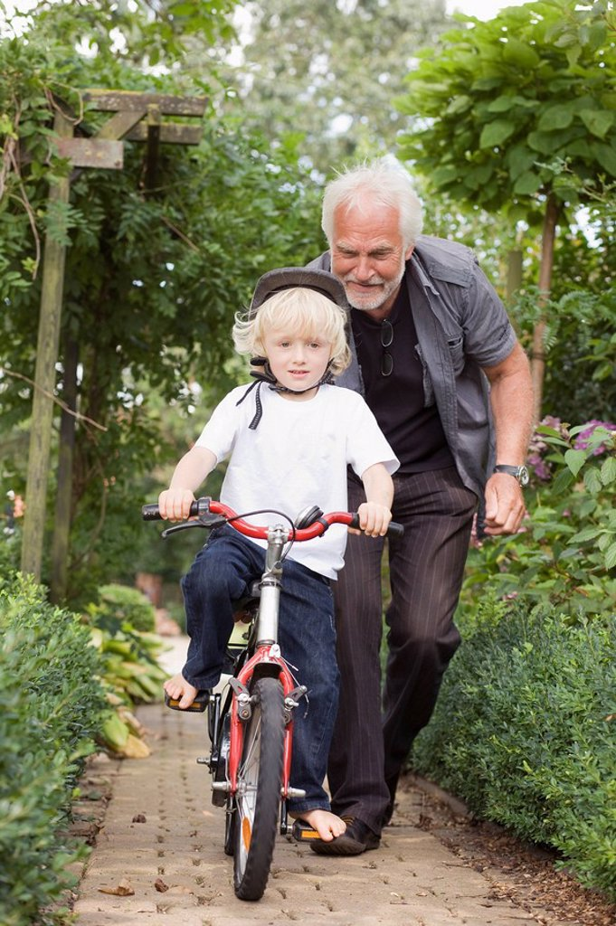 Stock Photo: 1773R-120230 learning to ride a bicycle