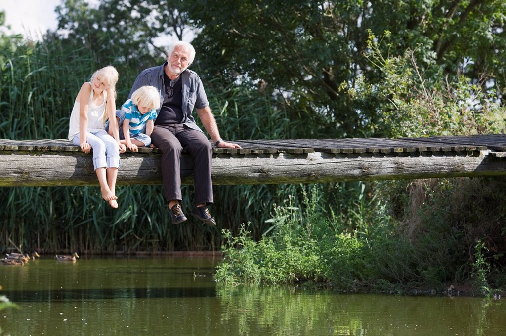 Stock Photo: 1773R-120248 grandfather and children on footbridge