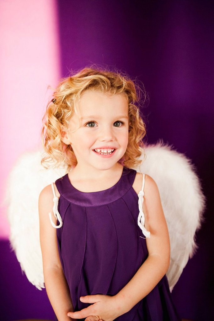 young girl in angel costume : Stock Photo