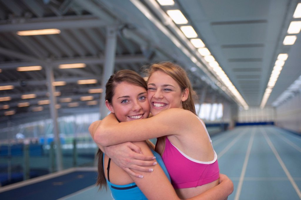 Stock Photo: 1773R-122227 2 female athletes embracing