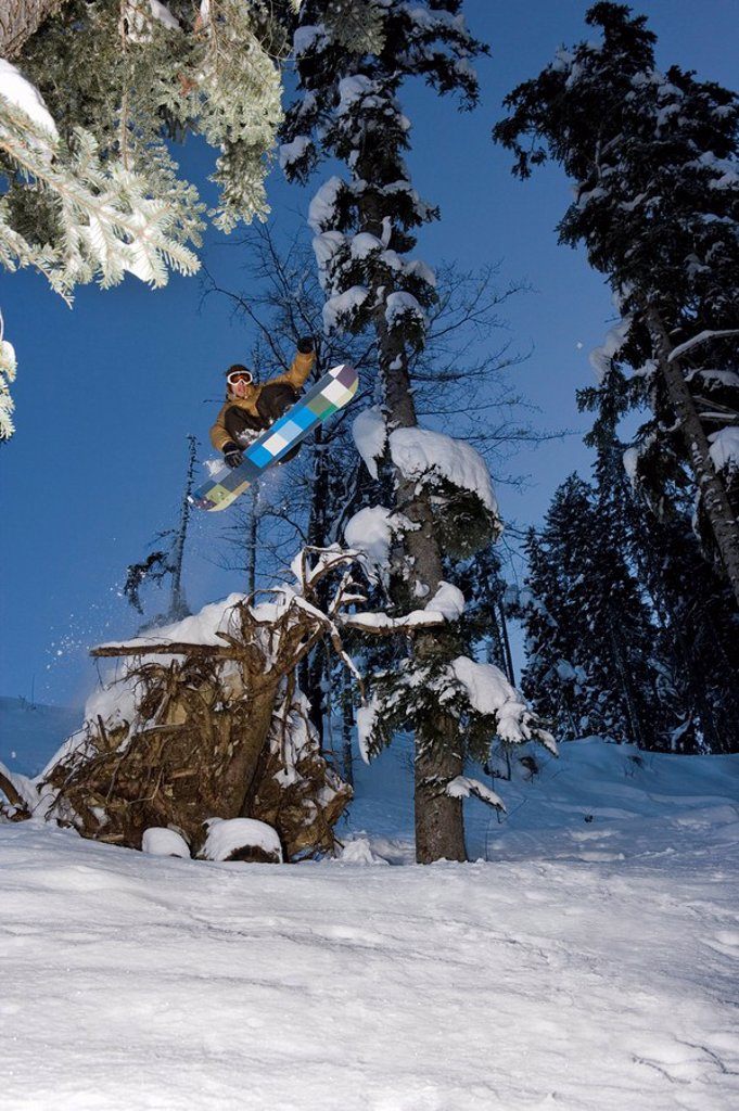 A snowboarder jumping : Stock Photo