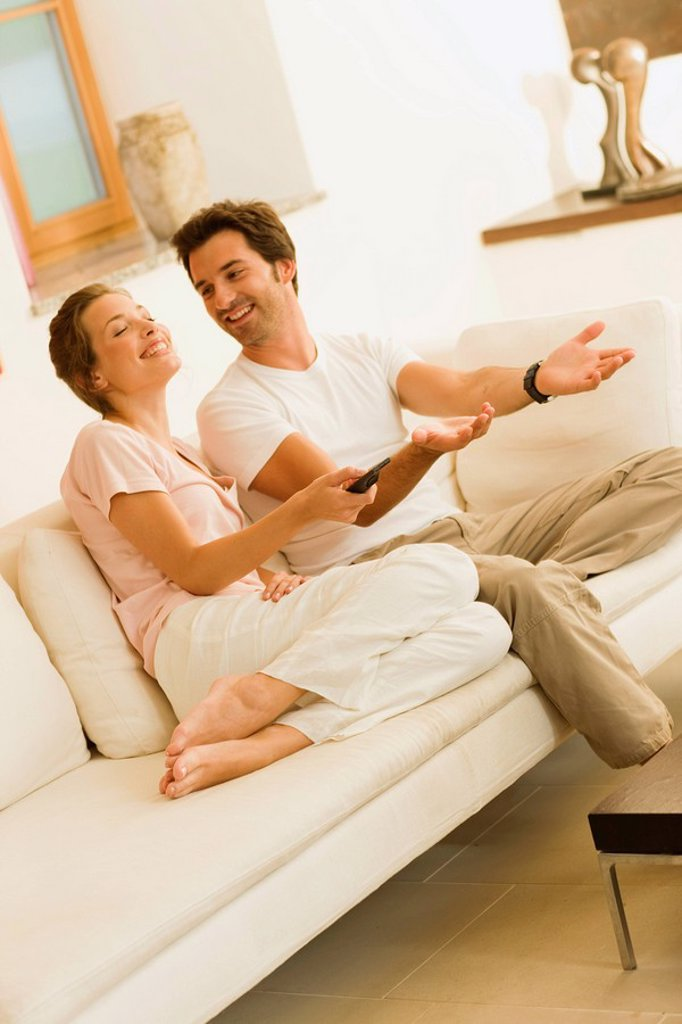 Stock Photo: 1773R-123530 Couple watching tv