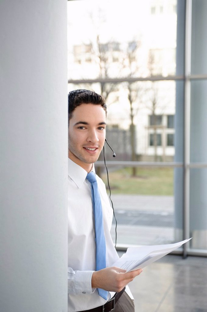 Stock Photo: 1773R-123817 Young business man in office, headset
