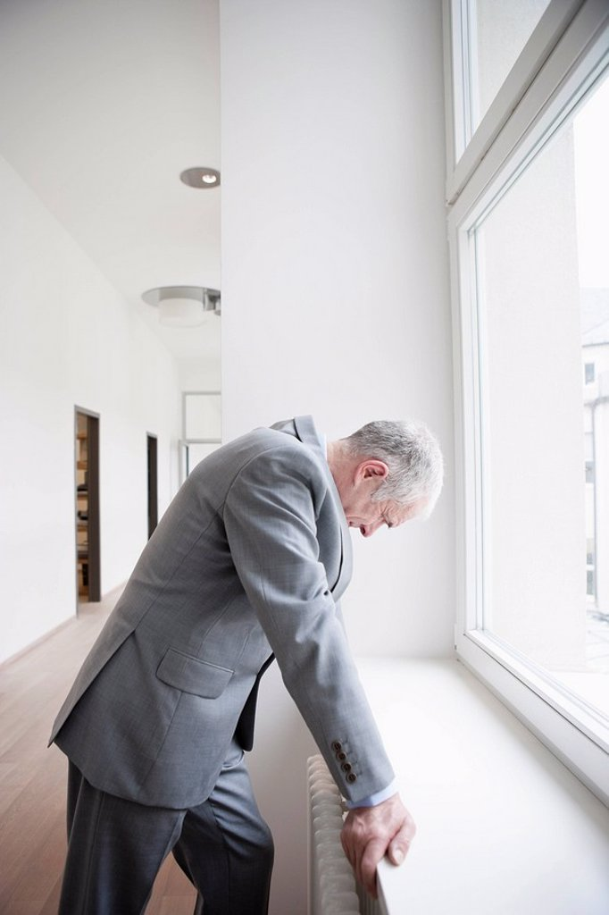 Stock Photo: 1773R-123942 Businessman leaning against window