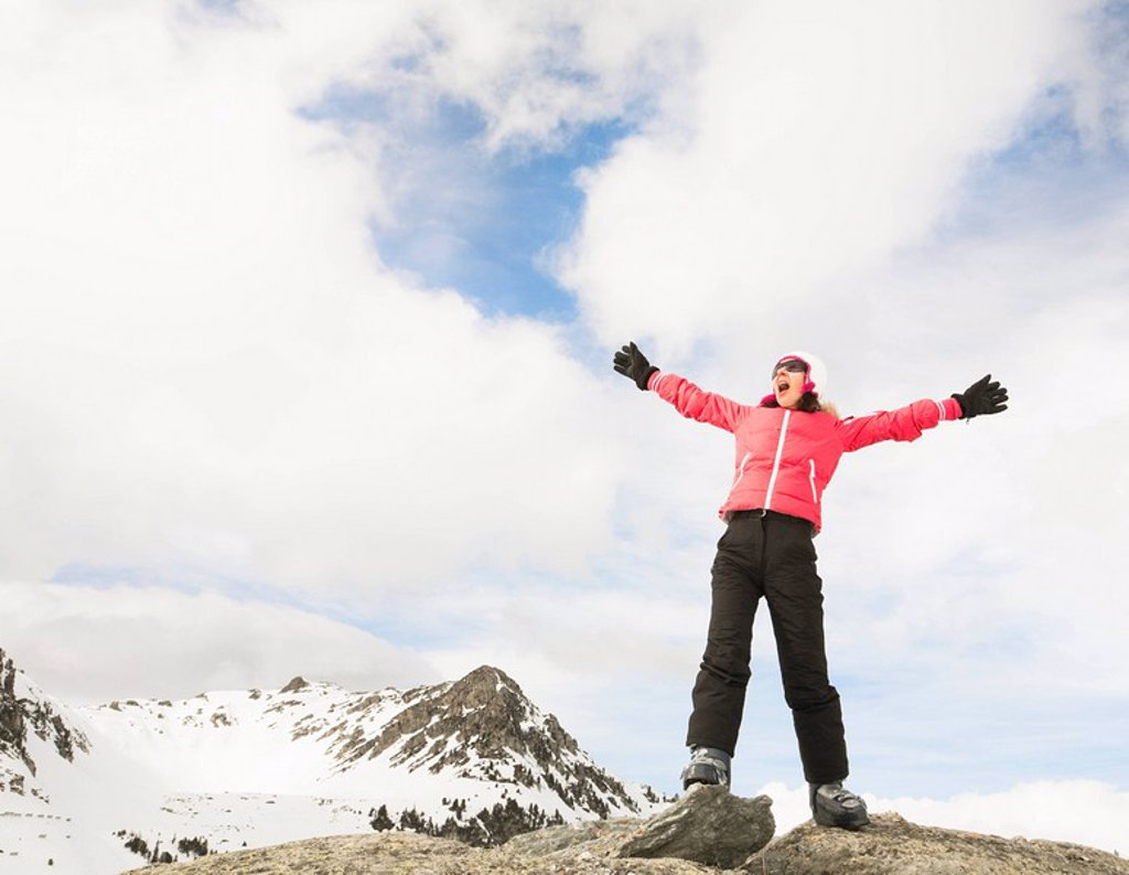 Stock Photo: 1773R-125924 Woman shouting from snowy mountain top