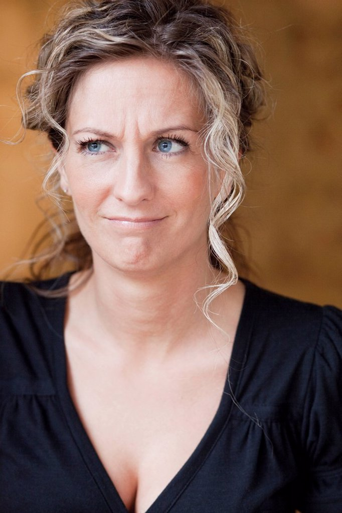 Stock Photo: 1773R-126242 Woman pulling a face
