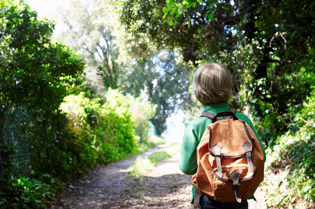 Stock Photo: 1773R-129948 Boy with his backpack, walking
