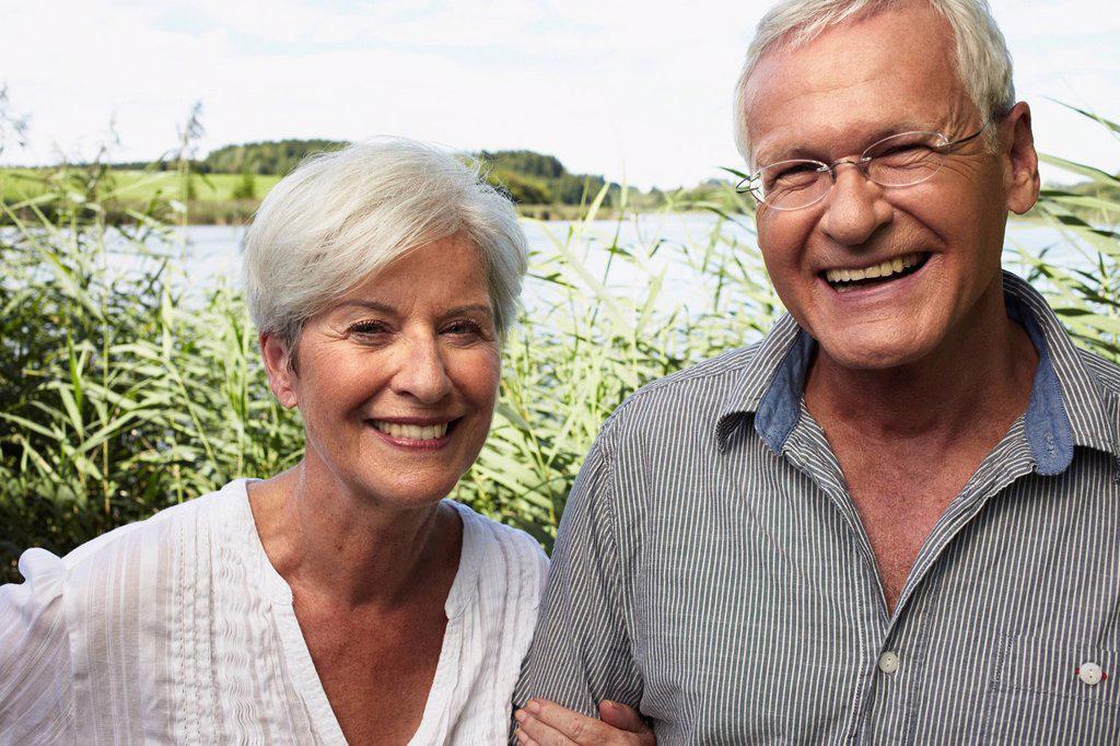 Stock Photo: 1773R-131106 Senior couple outdoors smiling to camera