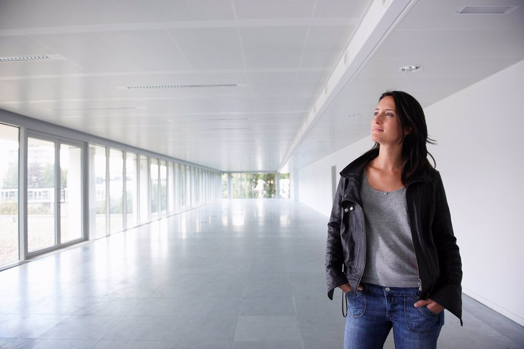 Stock Photo: 1773R-131350 Woman in empty office space