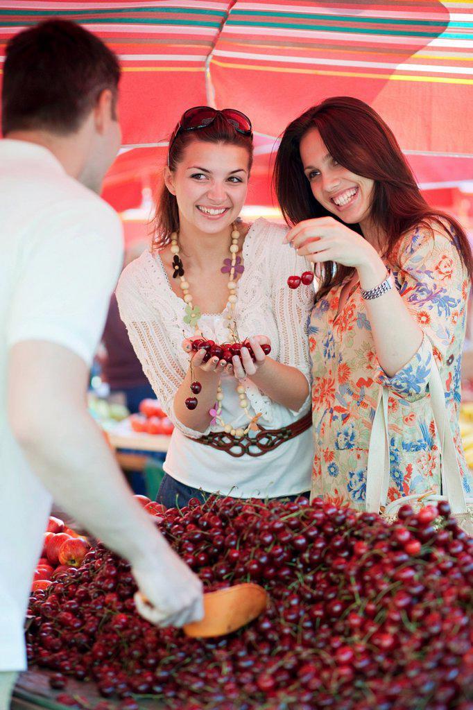 Young women shopping for fruit : Stock Photo
