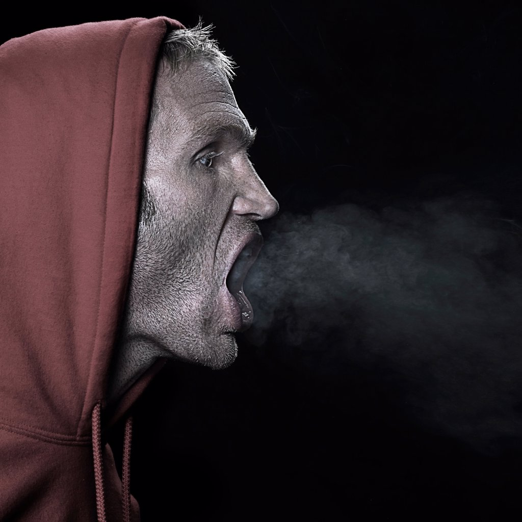 Stock Photo: 1773R-132930 Man breathing out