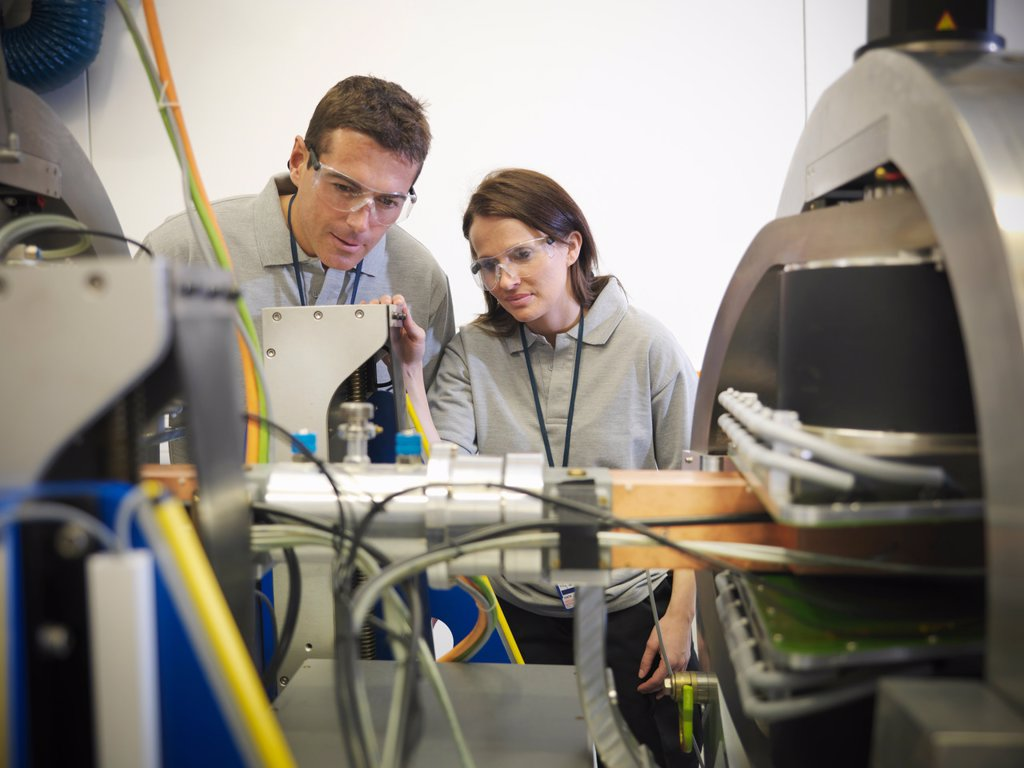 Scientists with particle accelerator : Stock Photo