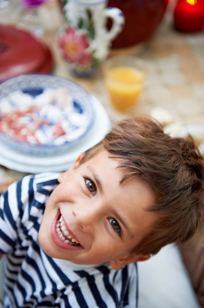 Stock Photo: 1773R-134348 Young boy having lunch