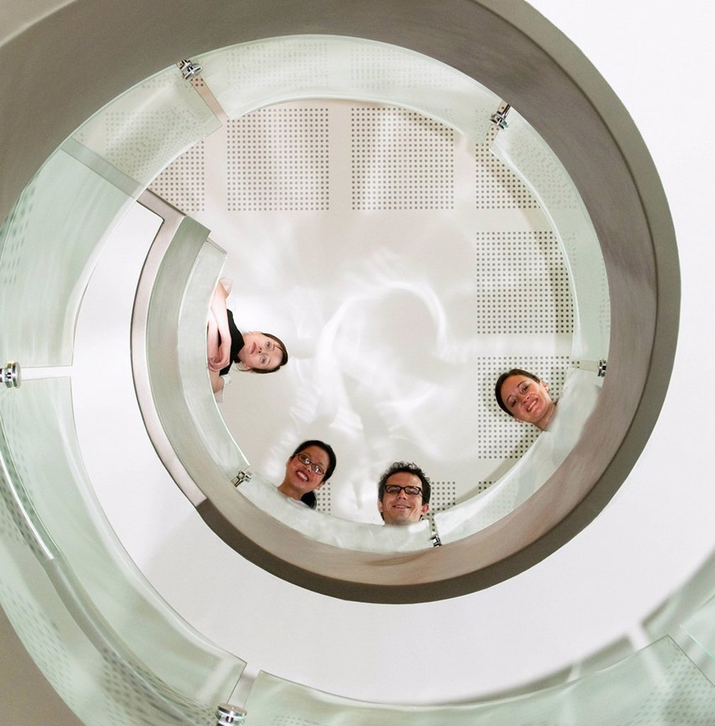 Stock Photo: 1773R-135896 Business team look down stair well