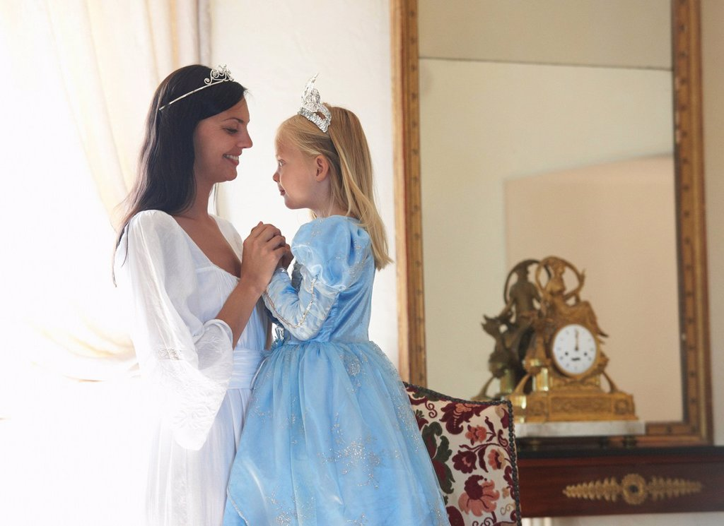 Stock Photo: 1773R-136902 Mother & daughter dressed as princesses