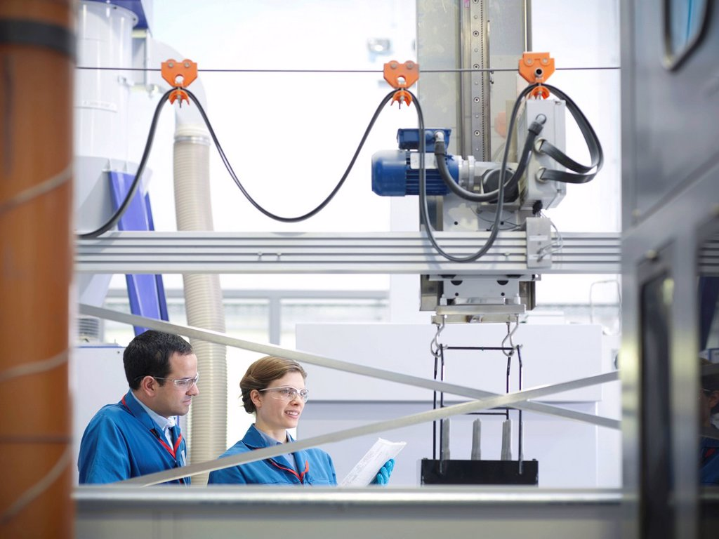 Stock Photo: 1773R-138583 Scientists with product being processed