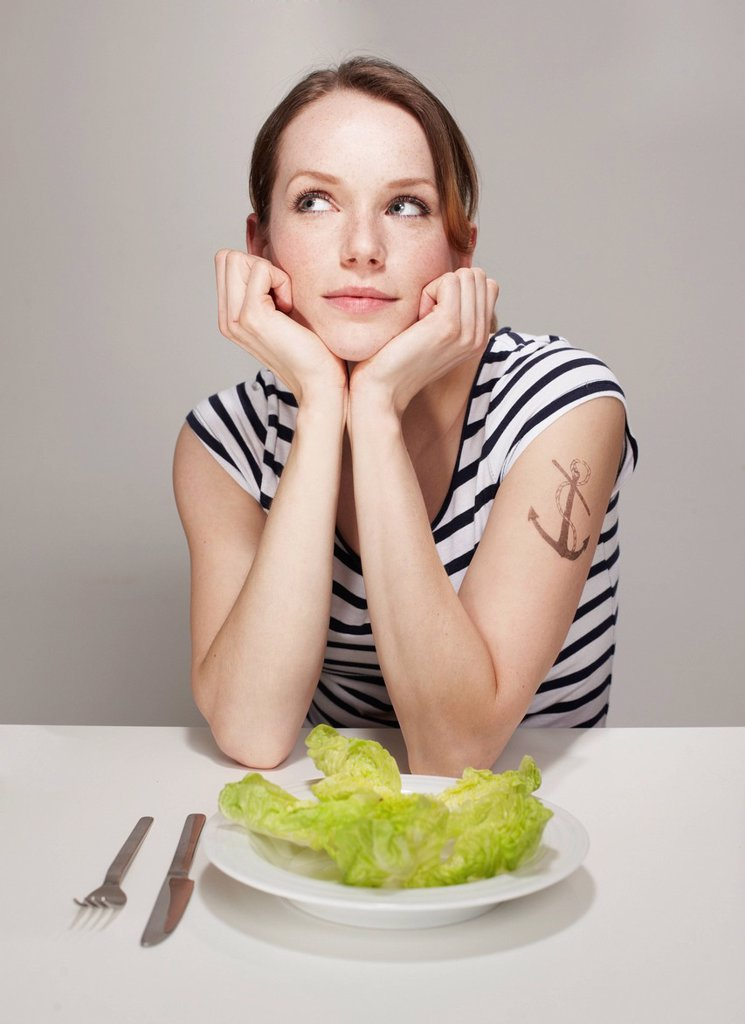 Women with Anchor Tatoo and Salad Plate : Stock Photo