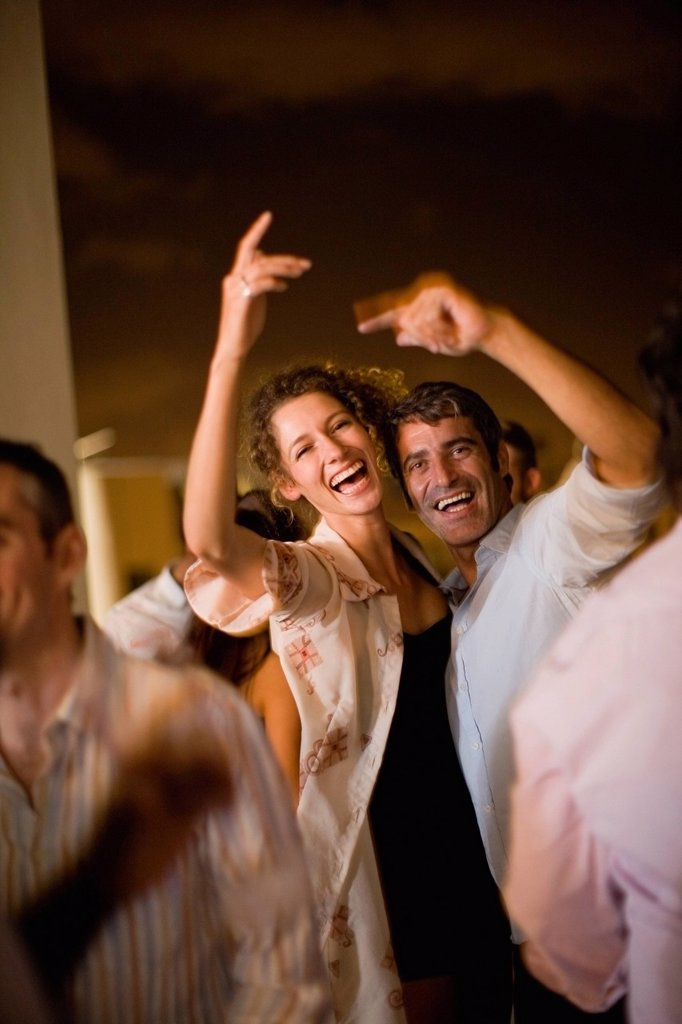 Stock Photo: 1773R-140811 Couple dancing at party at night