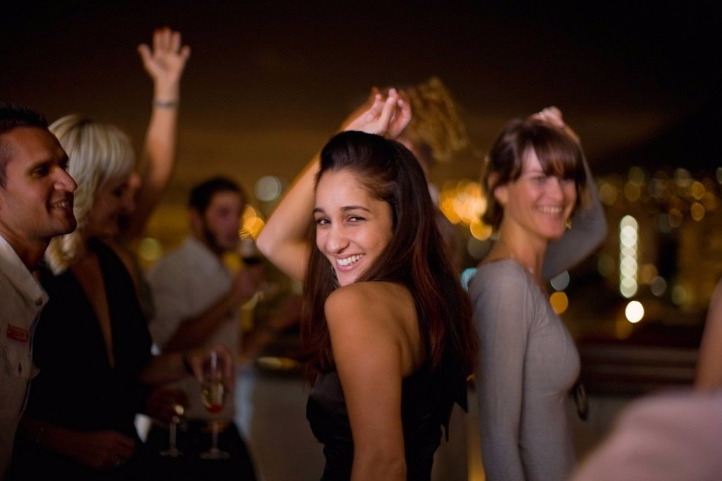 Stock Photo: 1773R-140814 Woman dancing at party at night