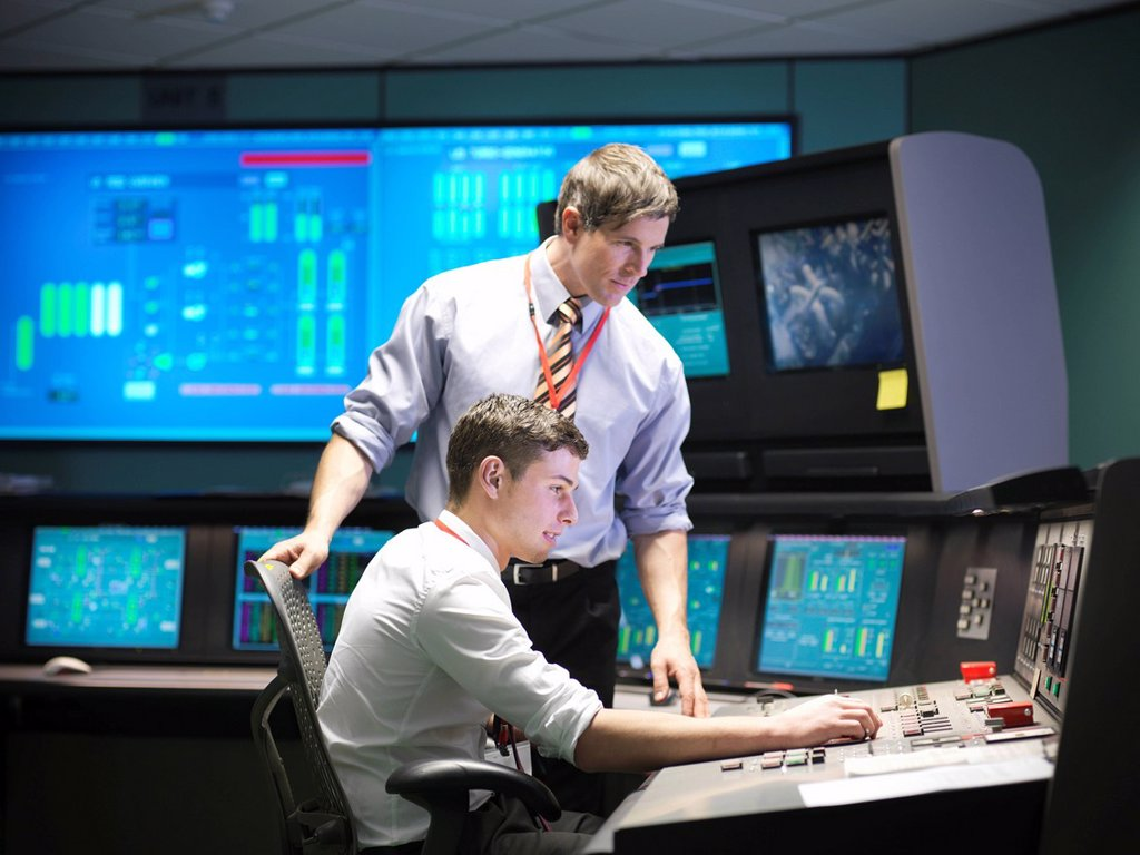 Stock Photo: 1773R-144824 Operators in power station control room