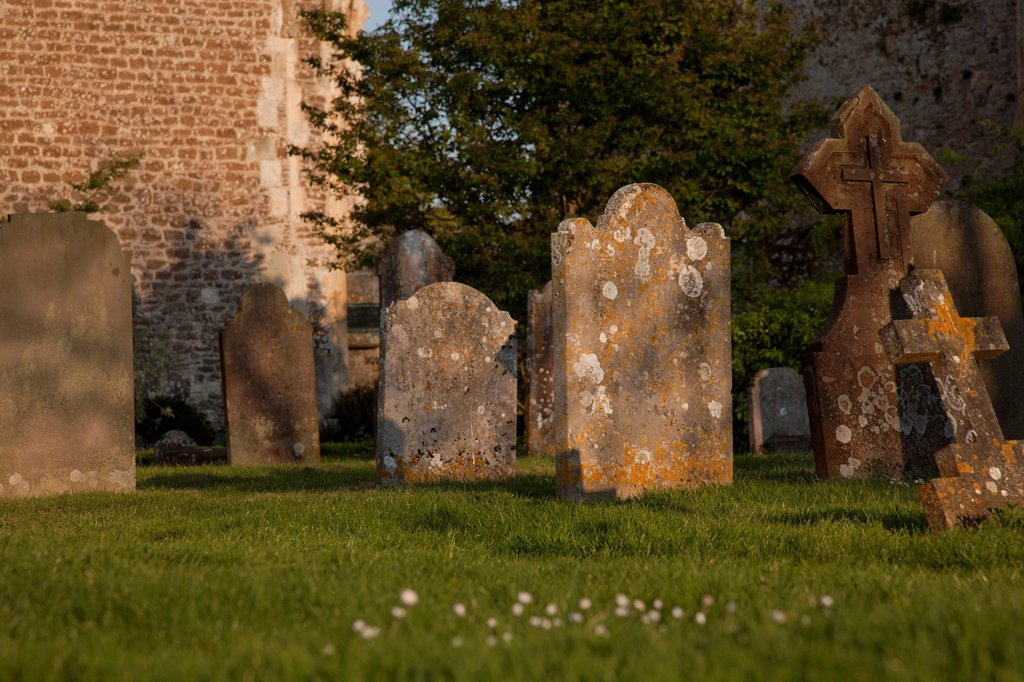 Old headstones in church graveyard : Stock Photo