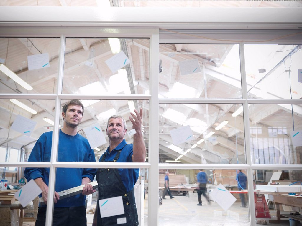 Workers examining window frames : Stock Photo