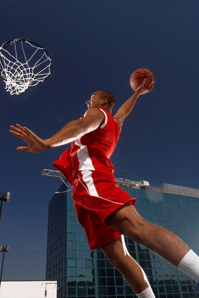 Stock Photo: 1773R-146855 Basketball player about to dunk