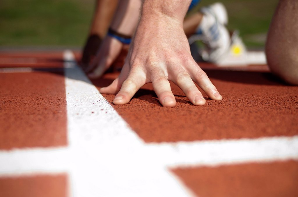 Stock Photo: 1773R-151162 Close up of athlete´s hand on track