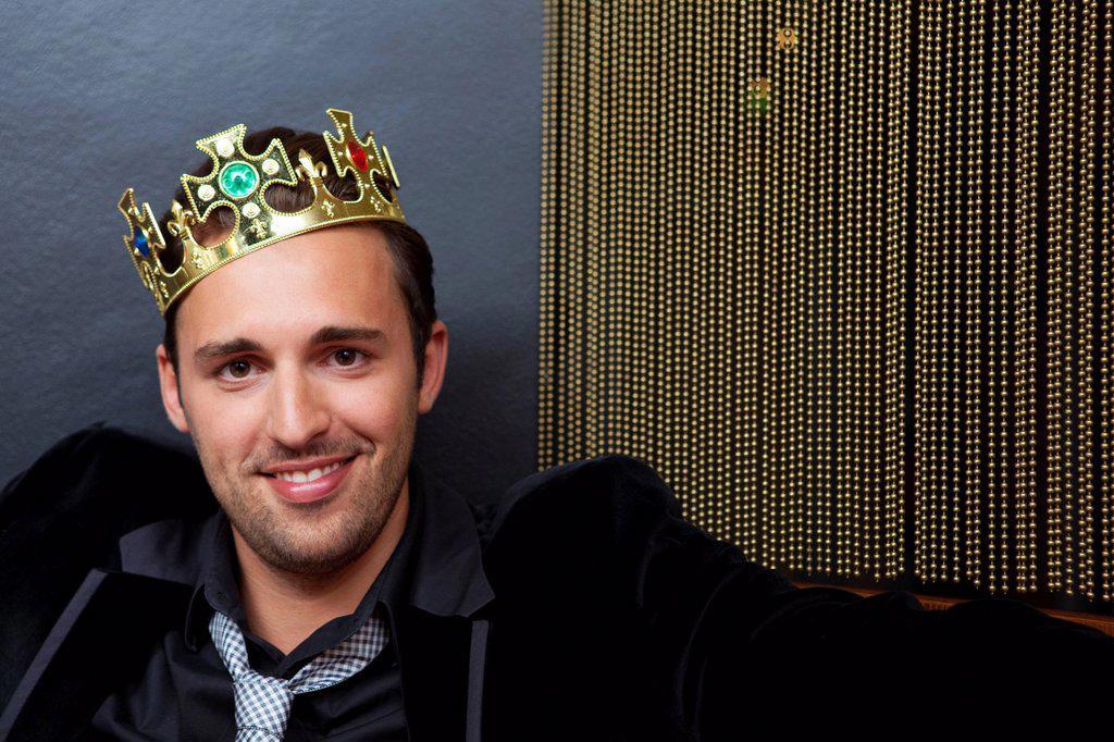 Stock Photo: 1773R-152154 Smiling man wearing plastic crown
