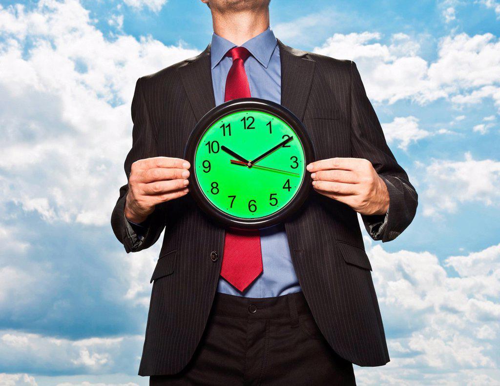 Stock Photo: 1773R-154151 Businessman holding clock
