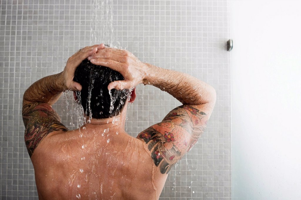 Stock Photo: 1773R-155297 Man washing his hair in shower