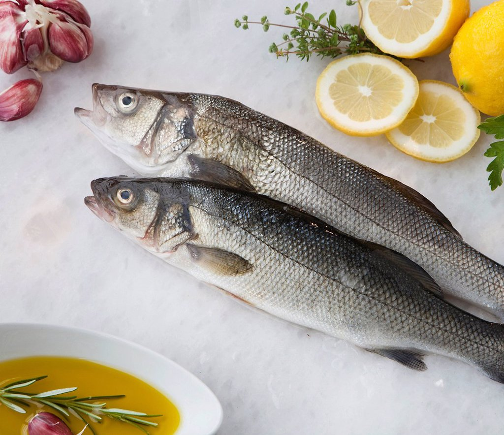 Stock Photo: 1773R-156994 Sea bass with lemon, olive oil and herbs