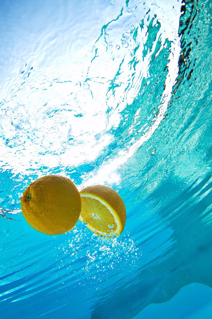Stock Photo: 1773R-157309 Lemon floating in swimming pool