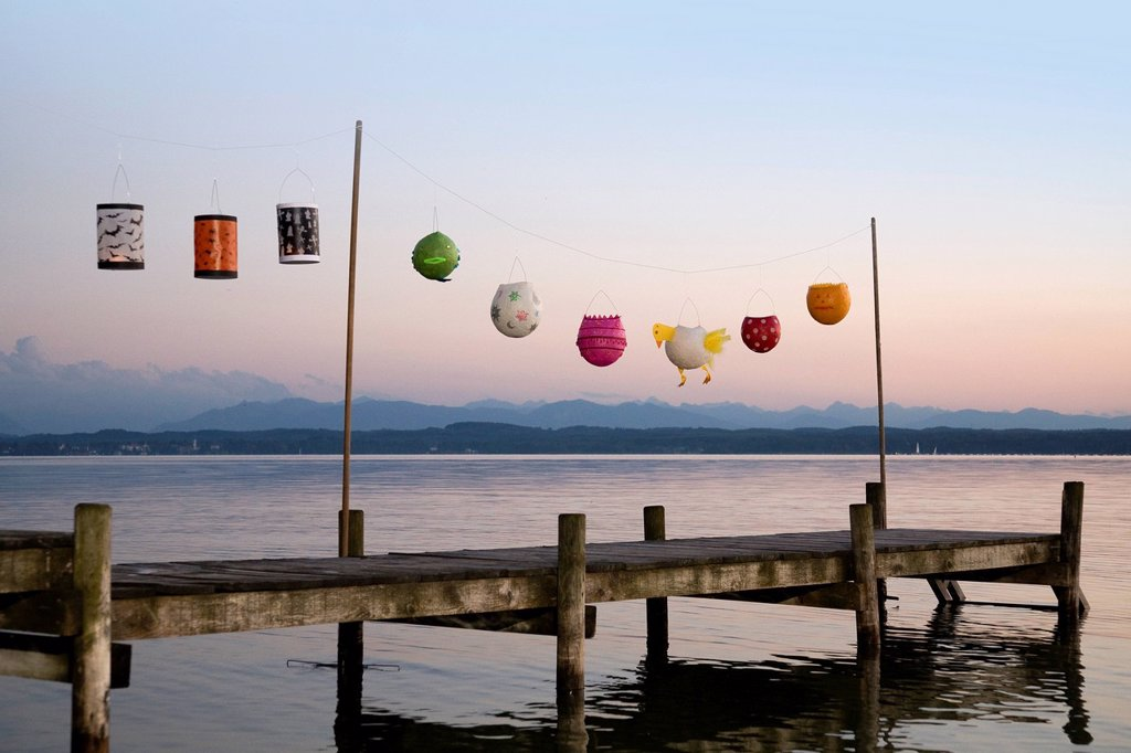 Stock Photo: 1773R-160359 Paper lanterns strung up on wooden pier