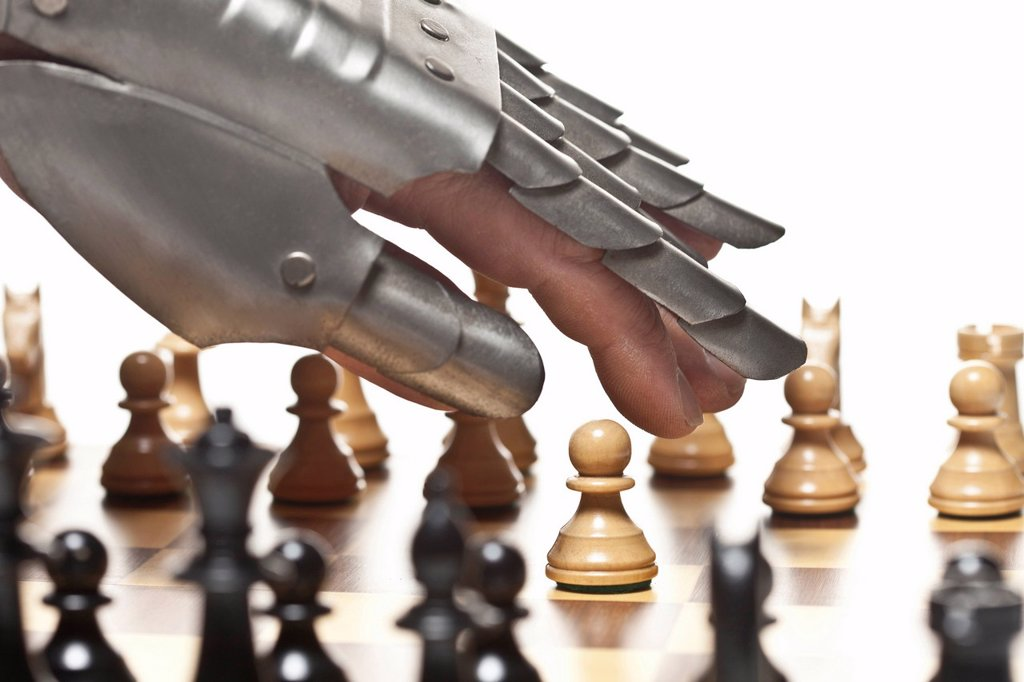 Stock Photo: 1773R-161091 Close up of armored hand playing chess