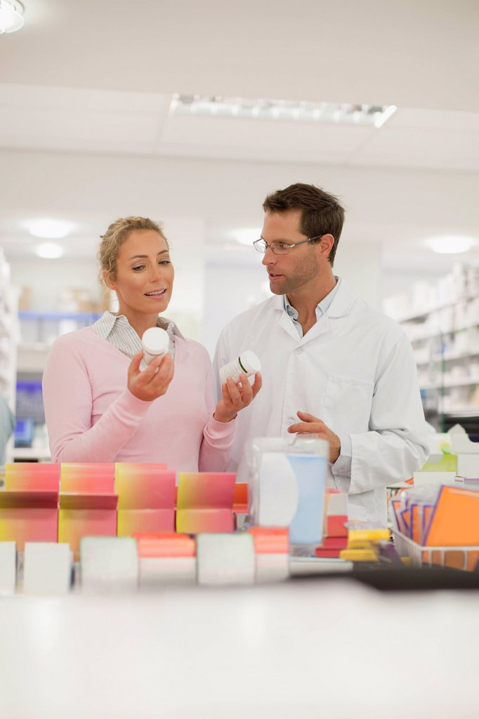 Stock Photo: 1773R-161880 Pharmacist helping patient in store