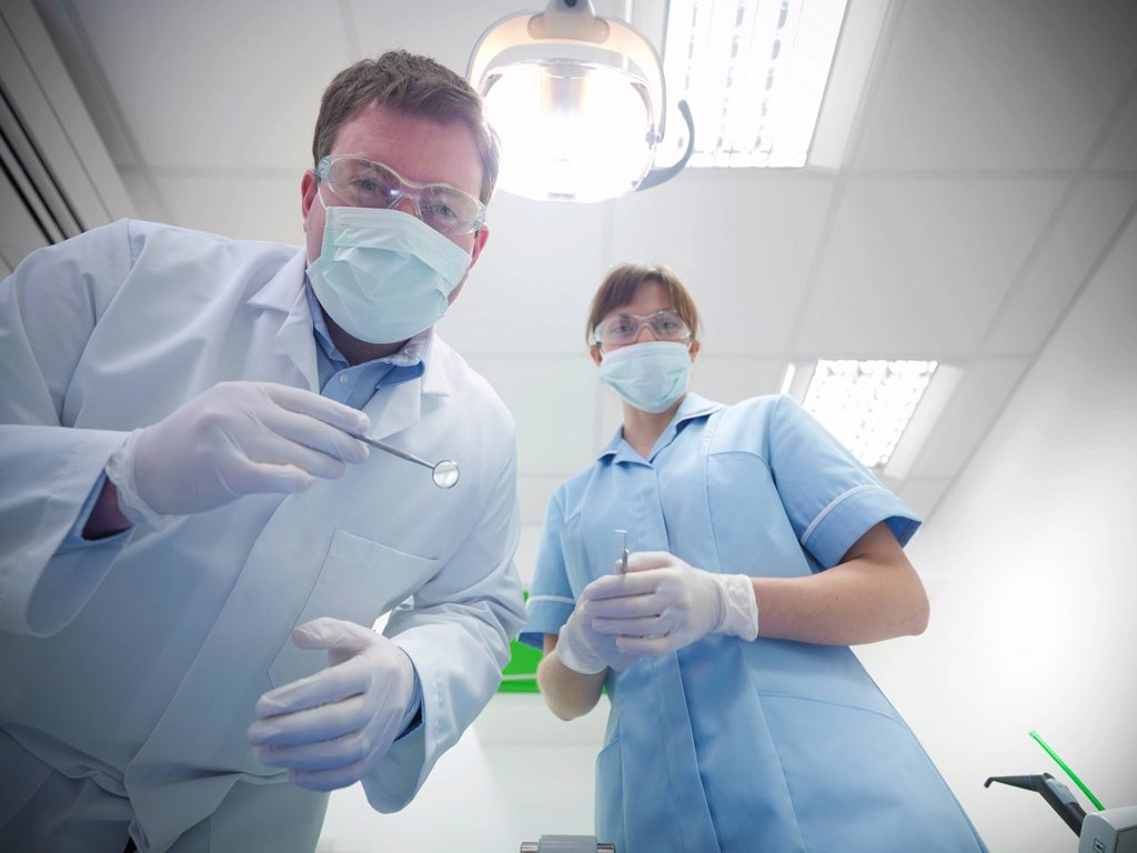 Stock Photo: 1773R-162408 Dental student and dentist in surgery
