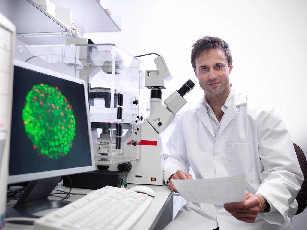 Stock Photo: 1773R-165795 Scientist using microscope in lab