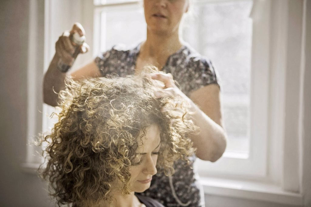 Stock Photo: 1773R-166959 Hair stylist working on client