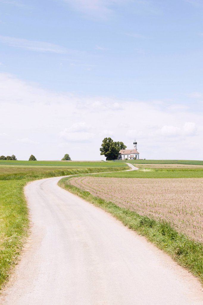 Stock Photo: 1773R-168577 Dirt road in rural landscape