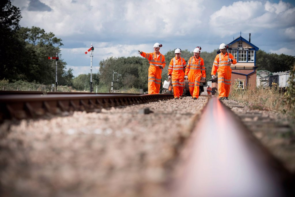 Stock Photo: 1773R-170454 Railway workers walking on train tracks