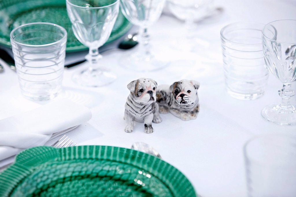Dog figurines on table : Stock Photo
