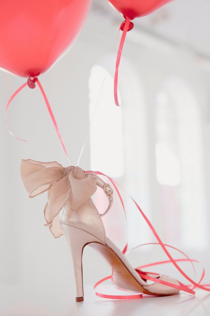 Balloons attached to high heel : Stock Photo