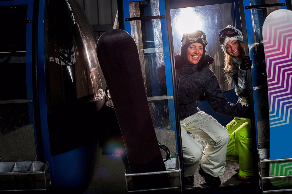 Snowboarders riding in cable car : Stock Photo