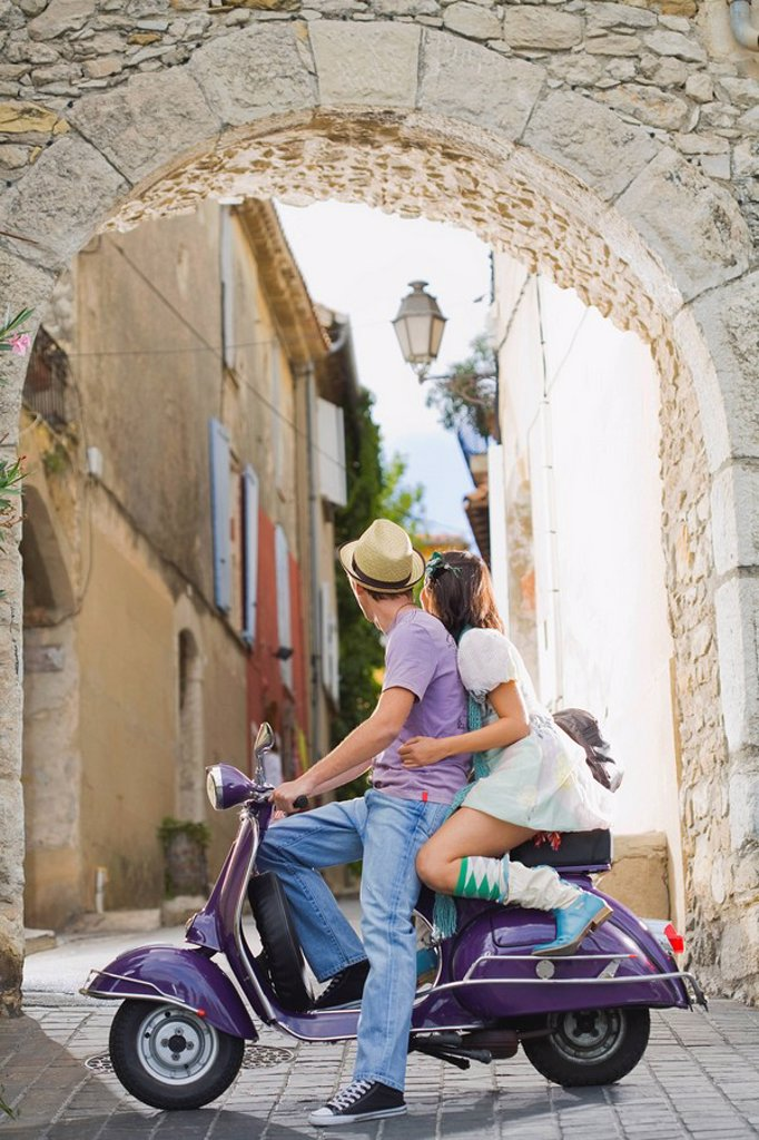 Man and woman on scooter : Stock Photo