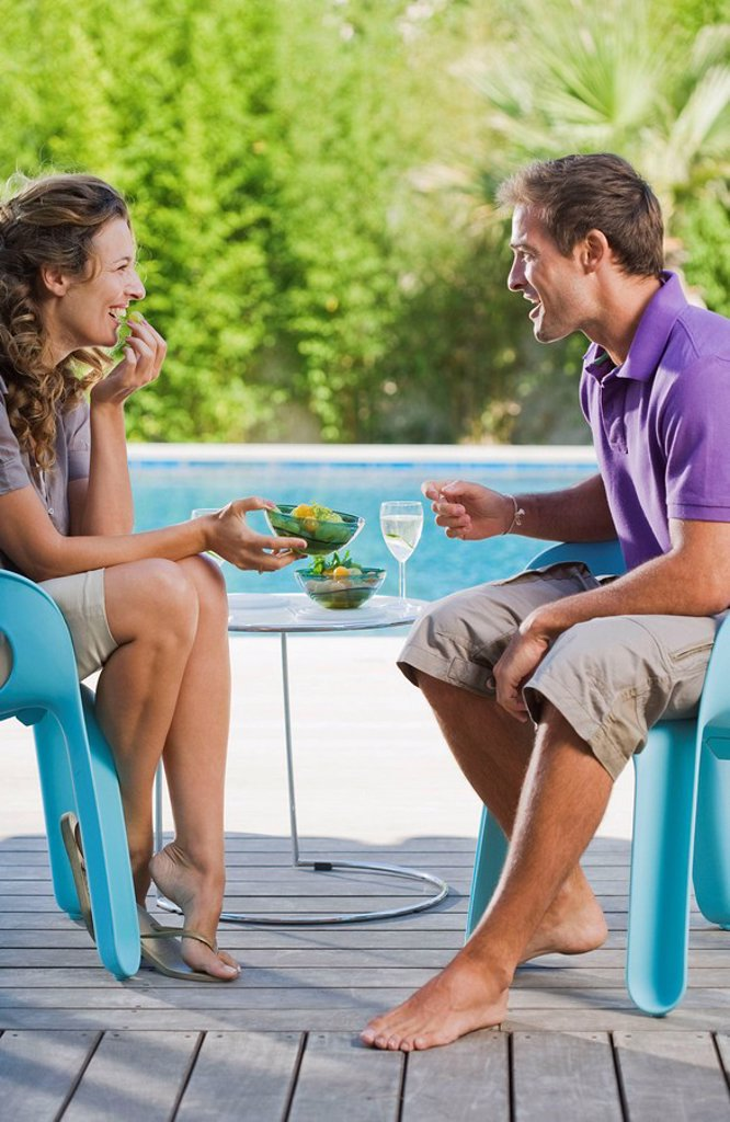 Stock Photo: 1773R-176147 Couple on a wooden terrace by a pool