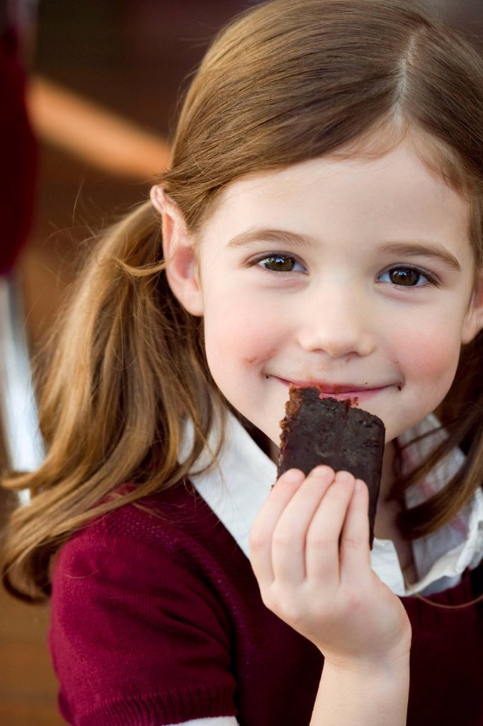 Stock Photo: 1773R-176293 Girl eating chocolate cake
